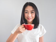 Woman drinks coffee. Royalty Free Stock Photography