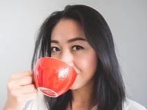 Woman drinks coffee. Stock Photo