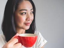 Woman drinks coffee. Stock Photography