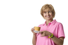 Woman drinks coffee and smiles Stock Photos