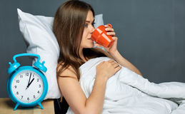 Woman drinks coffee under blanket. After awakening woman drinks coffee under blanket. Best morning time Stock Photos