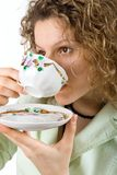 Woman drinks from a cup Royalty Free Stock Photo