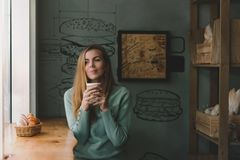 Woman drinks fragrant coffee royalty free stock photos
