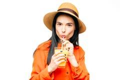 Woman drinks freshly squeezed orange juice Royalty Free Stock Photos