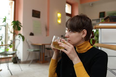 Woman drinks green tea Royalty Free Stock Photos