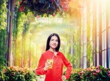 Woman drinks orange juice Stock Photo