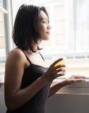 Woman drinks orange juice royalty free stock images