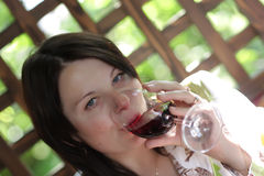 Woman drinks red wine Stock Images