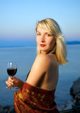 Woman drinks red wine Stock Photography