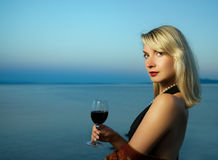 Woman Drinks Red Wine Stock Photo