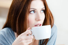 Woman drinks tea Royalty Free Stock Images