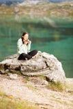 Woman drinks tea in nature Stock Photo