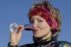 Woman drinks a vine from a glass Royalty Free Stock Image