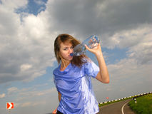 Woman drinks water Royalty Free Stock Photo