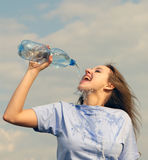 Woman drinks water Royalty Free Stock Photography