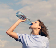 Woman drinks water Royalty Free Stock Photos