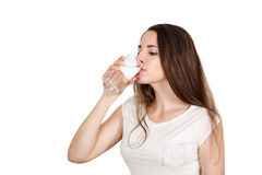 Woman drinks water Royalty Free Stock Images