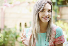 Woman drinks water. Beautiful young woman drinks water from a glass Royalty Free Stock Photography