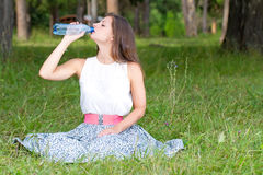 Woman drinks water from bottle Royalty Free Stock Image