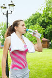 Woman drinks water. A woman drinks water from a bottle Royalty Free Stock Images