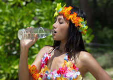 Woman drinks water. From a bottle Stock Image