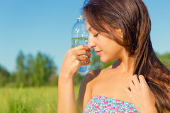 Woman drinks water from a bottle Royalty Free Stock Photos