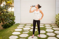 Woman drinks water after sport. Stock Photography