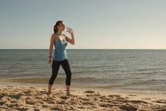 Woman drinks water Stock Photo