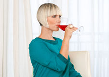 Woman drinks wine Stock Photos