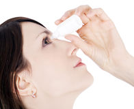 Woman dripping eye with eyes drops Stock Photography