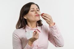 Woman drips drops for nose, White background. Woman drips drops for nose. White background Royalty Free Stock Image