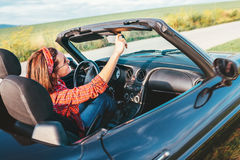 Woman drive a cabriolet car Stock Images