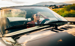 Woman drive a cabriolet car Stock Image