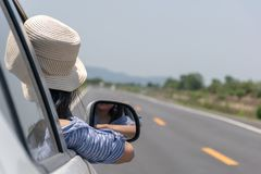 Woman drive a car on the road with. A mountain Royalty Free Stock Photos