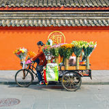 Woman drive the flower trade stand. Royalty Free Stock Images