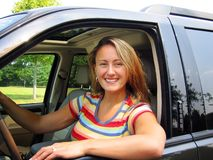 Woman Driver. A beautiful young woman driving a car, could be a soccer mom, or great auto insurance pic Stock Photos
