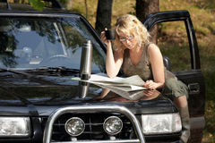A woman driver. A road map Stock Images
