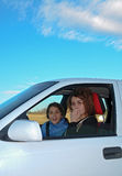 Woman driver. Two cute girls driving in a car. Only sky is a limit Royalty Free Stock Image