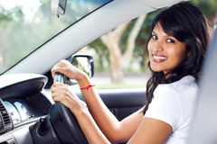 Woman driver. Young pretty indian woman driver driving a car Royalty Free Stock Photography