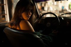 Woman driver behind steering wheel of retro car. Royalty Free Stock Images