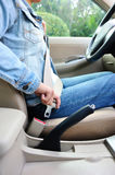 Woman driver buckle up the seat belt Stock Image