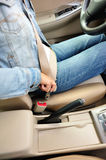 Woman driver buckle up the seat belt Royalty Free Stock Photo