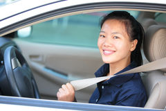 Woman driver buckle up seatbelt Stock Photography