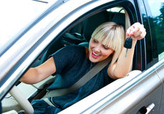Woman driver with car key Stock Photos