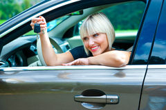 Woman driver with car key Royalty Free Stock Photos