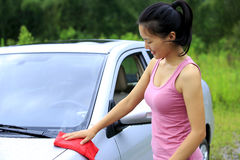 Woman driver clean car. With towel Stock Photo