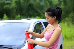 Woman driver clean car. With towel Royalty Free Stock Photo