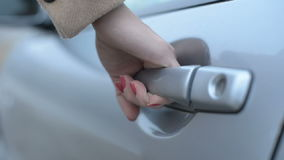 Woman driver close the car door stock footage