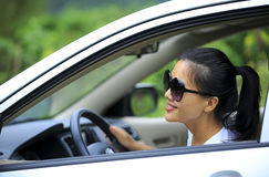 Woman driver driving Stock Photo