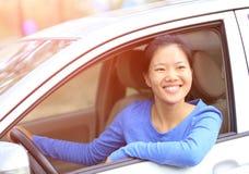 Woman driver driving a car Stock Photos
